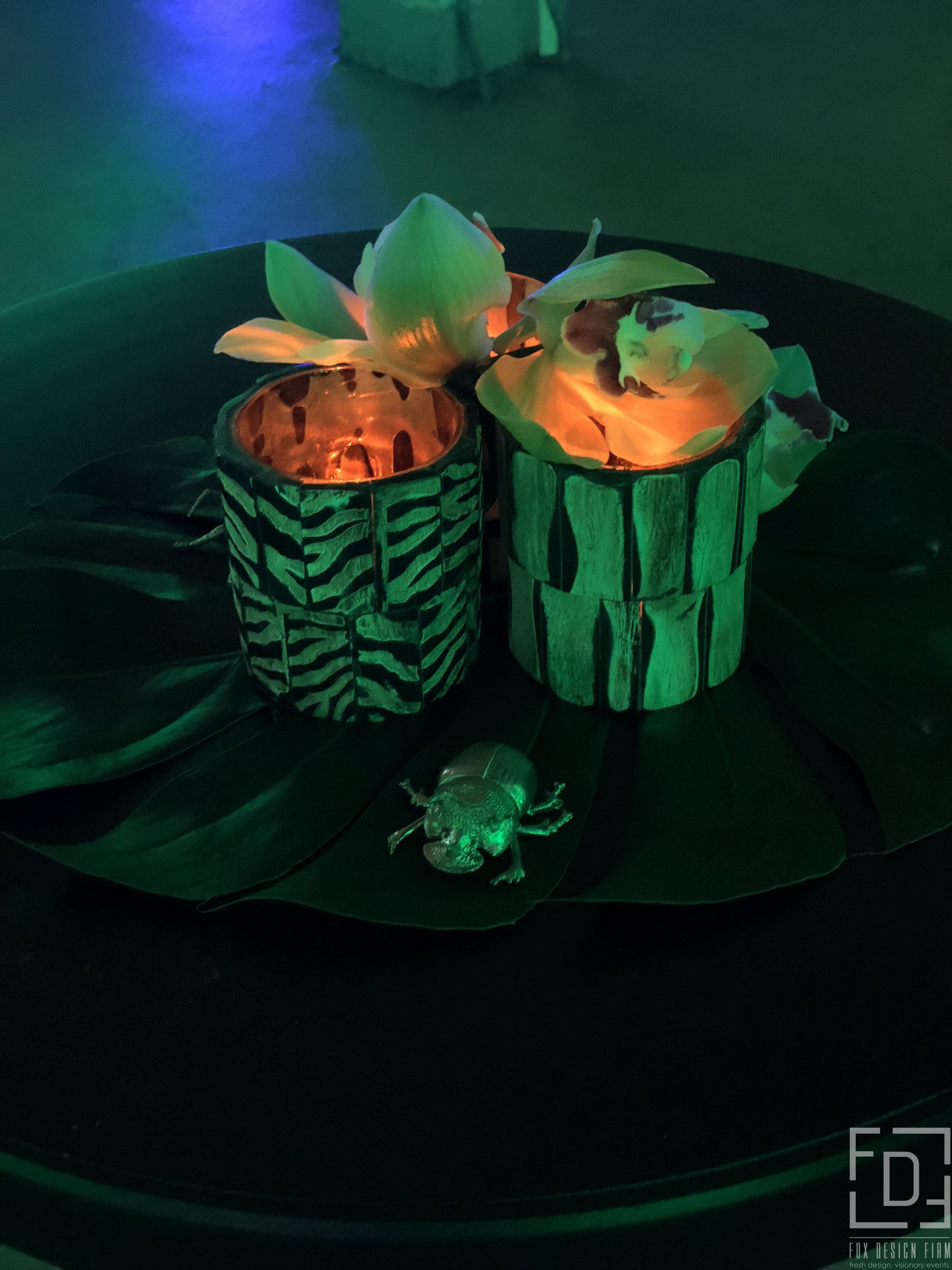 tropical bug centerpiece event design