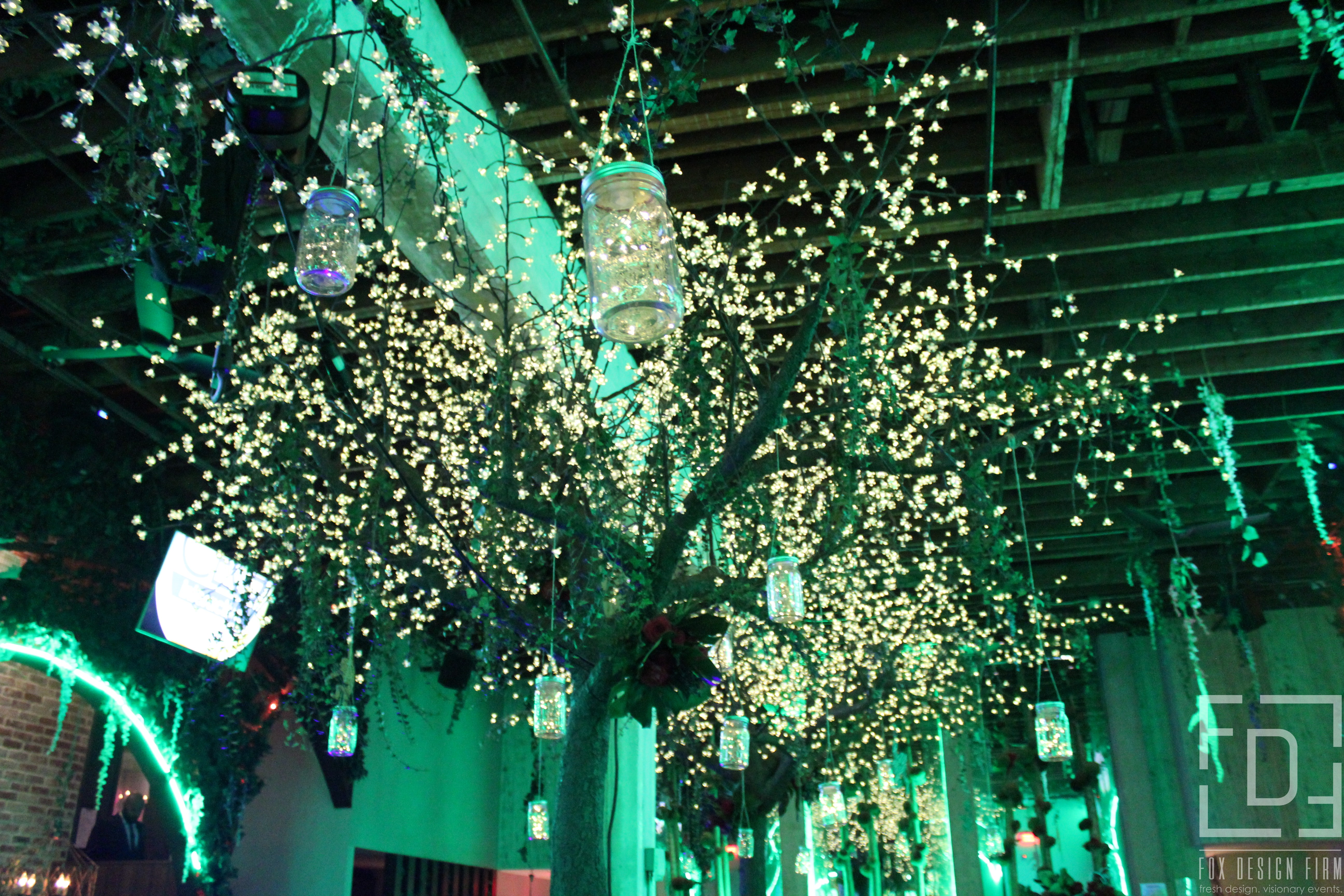 hanging lights at jungle themed event